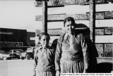 Two Indian Women standing in front of wagon