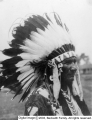 An Indian in headdress