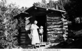 Woman and Child at Cabin door