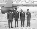 Military Officials Standing in Front of Athena Missile