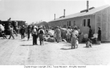 Trucks unloading Japanese American belongings