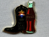 PIN, COWBOY BOOT AND COKE
