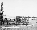 Wagon and Five People at Swan Lake Camp