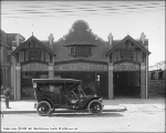 S. H. Sharman, Auto in Front of Building