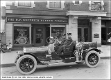 B. F. Goodrich Rubber Company, Chief Fire Auto in Front of Store
