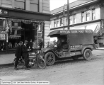 B. F. Goodrich Rubber Company, Official Guide Post Truck in Front of Store
