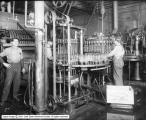 Universal Bottle Washer Company Bottling Machine at Fisher Brewing Company