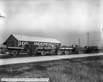 Independent Oil Trucks in Front of Warehouse