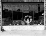 Auto Supply Company Window with Goodrich Tires and Girl
