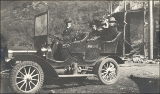 """Andy"" Anderson in his E. Maxwell Flanders car.  Riding in the back of the car; Mr. and..."