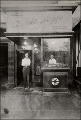 """J. Willard Marriott stands in the doorway of his rootbeer stand in Washington D.C.,..."