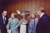 J. Willard and Alice Sheets Marriott with an unidentified couple looking at a sculpture titled...