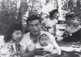 Wallace and Mary Doi with their daughter Kimie.