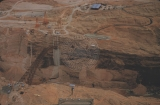 Aerial photos of dam site and bridge construction.