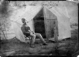A.C. Allen sitting in front of his tent during the Ute Campaign.