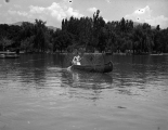 Woman canoeing on a lake at Wandamere Park [2]