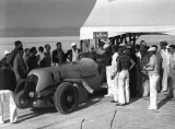 "Ab Jenkins sitting inside his racing vehicle the ""Mormon Meteor"" outside the pit area on..."