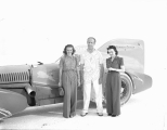 "Ab Jenkins and two women next to his racing vehicle the ""Mormon Meteor"" on the..."