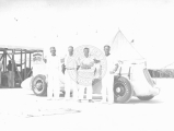 "Ab Jenkins and three men next to Jenkins' racing vehicle the ""Mormon Meteor"" on the..."