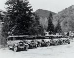 [Line of cars parked in front of a hotel.]