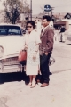 [Couple standing in front of a car.]