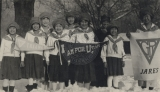 [Group of young women holding signs.]