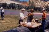 """Jack Reynolds, Dennis Massey"" Lunch table on boat at Deer Lodge Park, Yampa River"