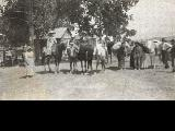 """At Woodside.""  McPherson family on horses and with pack horses at Woodside, Utah"