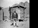 """Old Moon.""  Red Moon, Ute leader, in front of corn crib at Florence Creek (Cradle M)..."