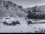 "Men and cattle fording Green River at ""Cow Swim.""  L-R: Don or Waldo Wilcox, Ray..."