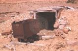 Abandoned ore cart near mining shaft.