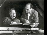 A. Rubenstein and Maurice Abravanel discussing a piano piece.