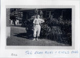 Bill Spencer as a young boy, wearing a baseball uniform for the Salt Lake City Elks Boys and Girls...