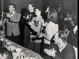 Suzy and other skiers receiving awards and trophies.  L-R: Ernie McCullough, Jack Reddish, ?,...