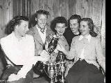 Group of skiers looking at a trophy.  L to R:  Betty Weir Bell, Gorda McClain, Suzy Harris...