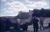 """Boat is put on truck then loaded with people and duffel for drive over rough road to Art..."