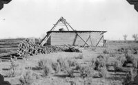 "(Fig. 25a) ""West view of Arrowchis Shaft showing head frame, loading platform (walled in on..."