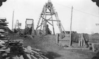 "(Fig. 26b) ""Headframes over tow chief shafts on the Raven Mining Company's portion of the ..."