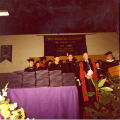 1980 Graduation: Faculty Members with Diploma Table