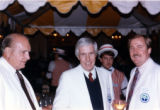 75th Anniversary - Men dressed in white suits