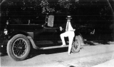 A. O. Jacobsonstanding beside his 1923 touring car