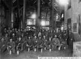 Miners in front of cages