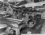 Men working in mill building