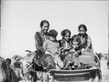 Navajo women on wagon at squaw dance Near Cow Springs