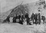 A group of St. George (Sibwit) Paiutes and Wickiups (cedar)