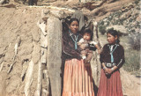 Navajo woman and two children at hogan