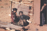 Navajo weaver and child