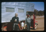 Father Liebler outside a camper having a picnic.