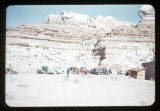 A Navajos and some trucks at St. Christopher's Mission;