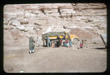A group of Navajo and a big yellow truck;